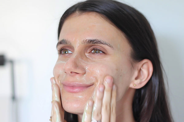 adi washing her face with Teami superfood face cleanser