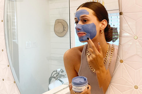 woman with the Teami Beauty Butterfly Mask on