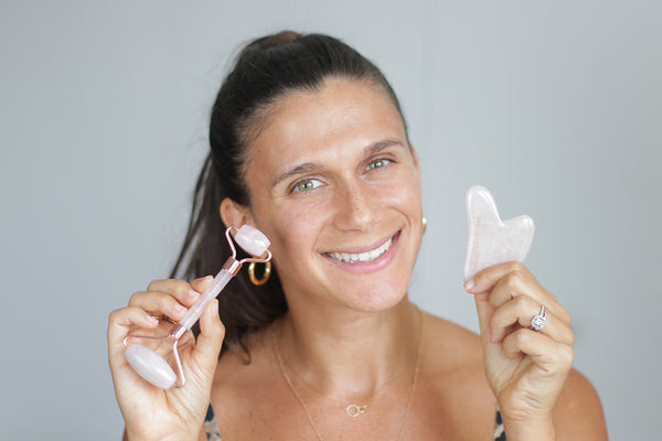 Adi with the Teami Rose Quartz Gua Sha and Facial Rollers