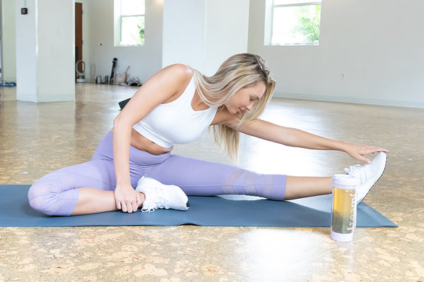 woman stretching with teami detox tea