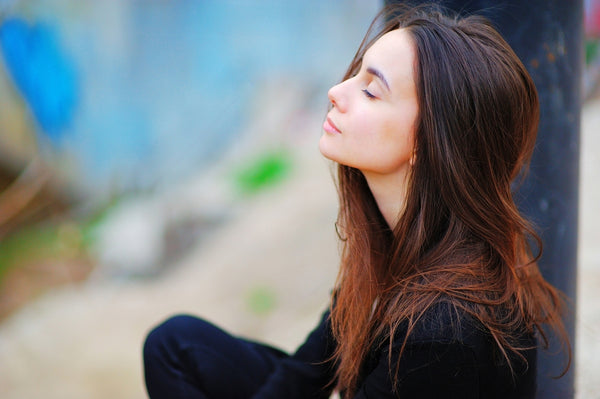 woman meditating and reciting her daily affirmations