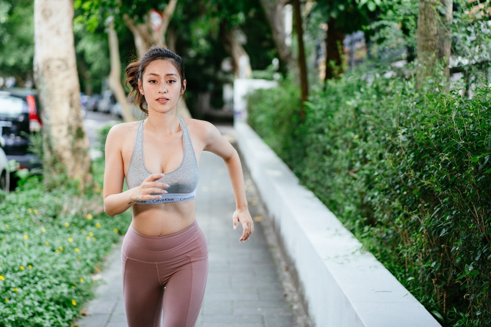 Woman living a healthy lifestyle and going for a run