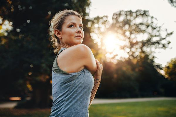 woman stretching before a workout