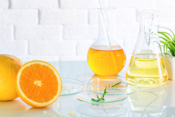 vitamin c as an orange and in a beaker
