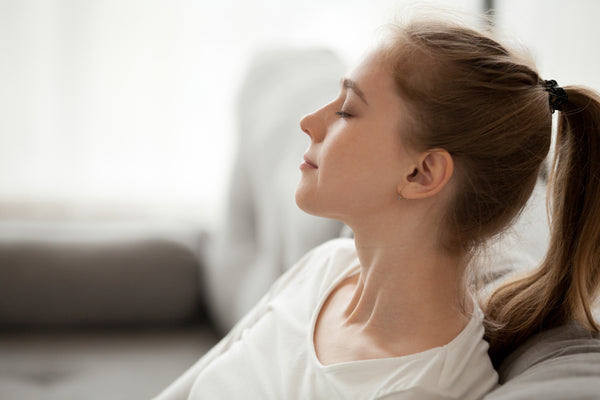 young woman practicing breathing calmly