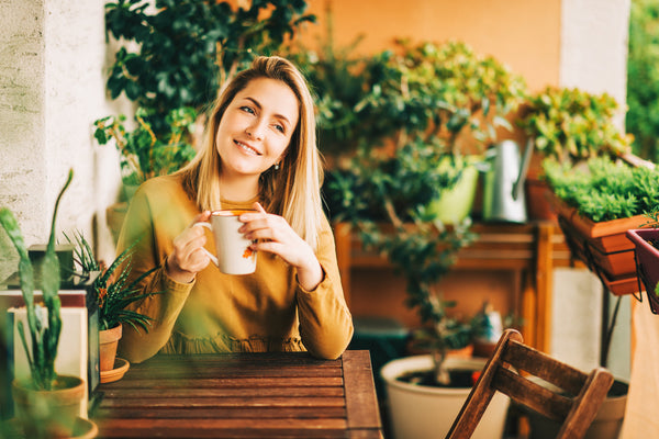 woman getting energy from green tea