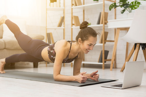How to increase immunity - woman following an exercise video online