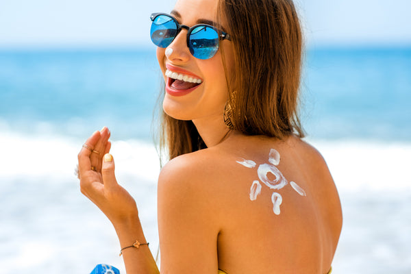 woman with sunscreen on at the beach