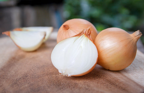 sliced and whole white onions