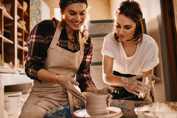 two women enjoying their hobby, making pottery
