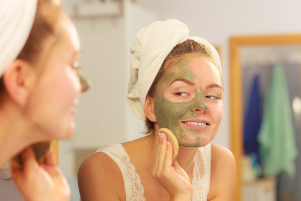 woman removing Teami Detox Clay Mask