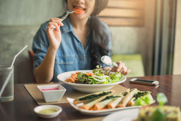 woman maintaining a healthy diet with salad