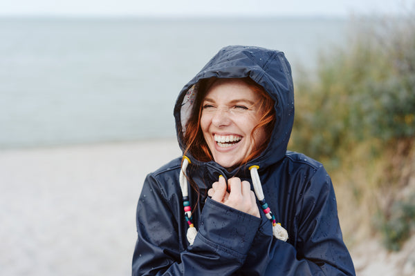 woman wearing a coat at the beach