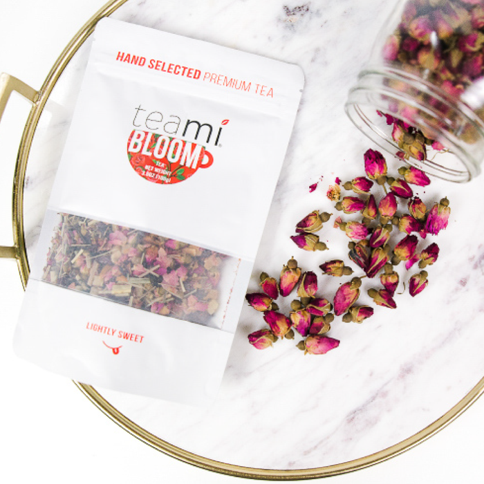 Teami Blends Bloom Tea spilling out of a jar