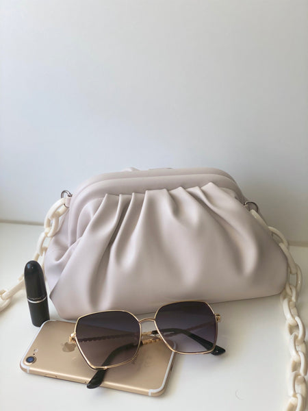 Sandy-neutral pouch bag