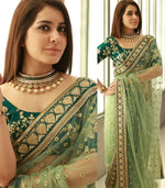Traditional Green Color Nylon Mono Net Heavy Sequence Work Party Wear Saree - Wear Your Glamour