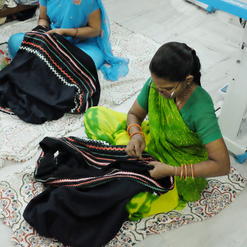 embroidering our upcycled skirt