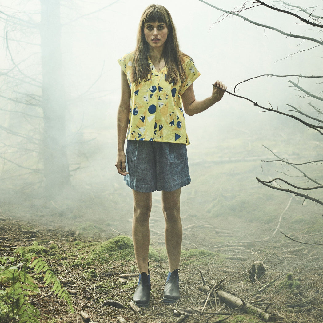 Female Model wearing Lowie Denim Tailored Shorts in the Forest
