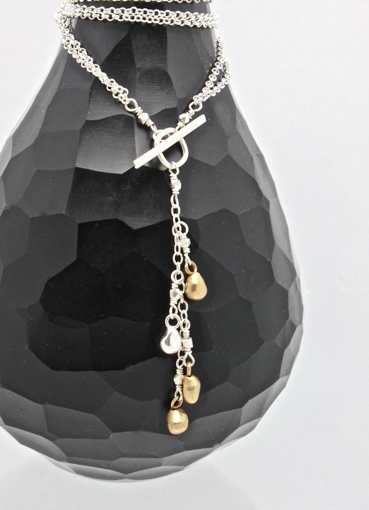 Arctic Blossoms: Cascading Lariat Bud Necklace
