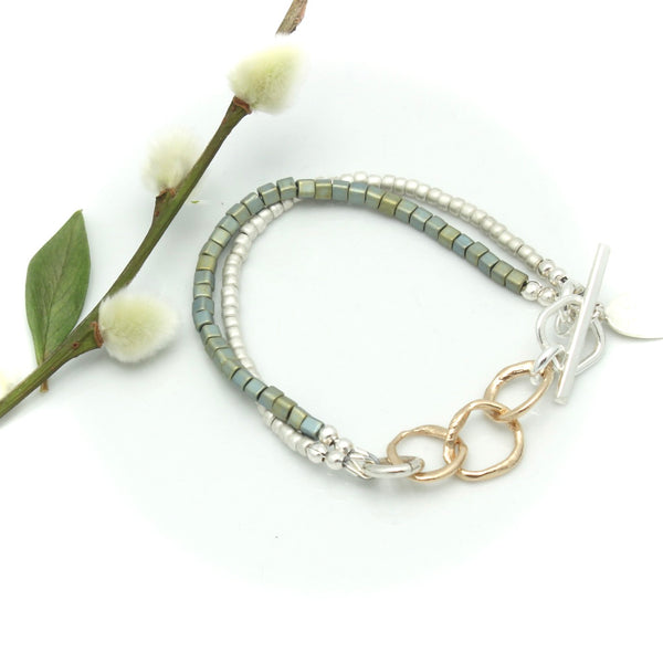 Arctic Blossoms: Snow Agate Stretch Bracelet with Bronze Petite Bud