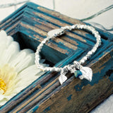 Wings of Hope: All Silver Changing Leaves Bracelet