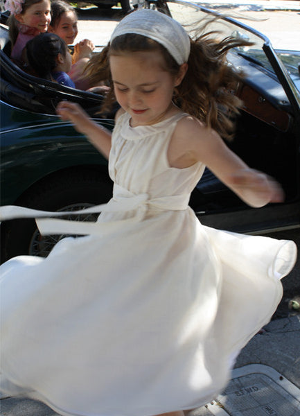 Beautiful White Tissue weight silk dress with an overskirt of silk organza and a cotton lining ideal for your girl having her holy first communion, Easter, baptism, wedding or any special occasion she may be in