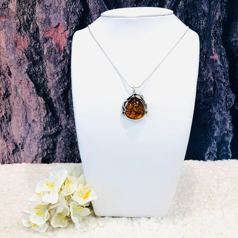 Amber and Silver Pendnat with a Leaf