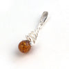 Baltic Amber Round Stone Silver Swirl Pendant available at The Amber Room