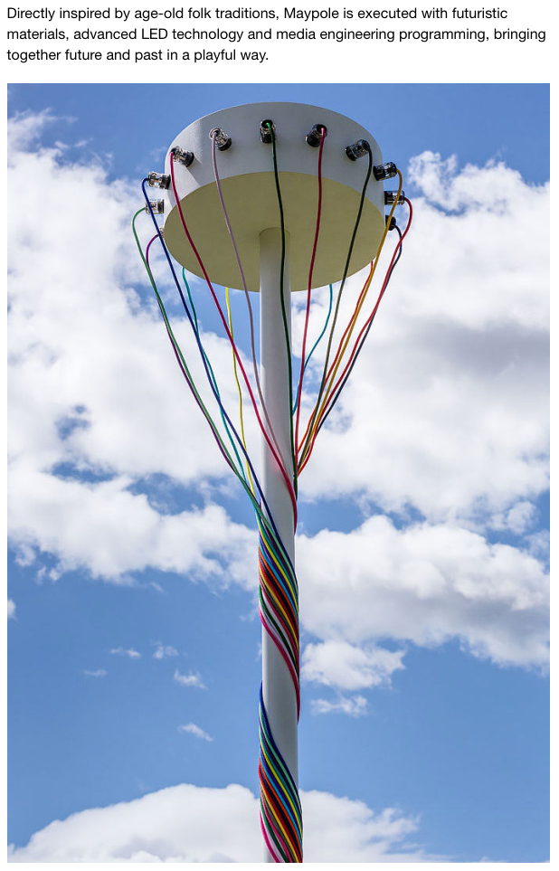 Colored electrical cords wrapped around a Maypole