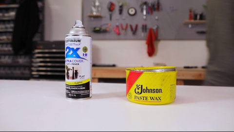 Aerosol can and can of wax sitting on workbench