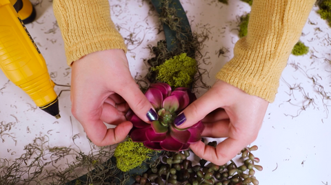 Woman add a flower in the Floral Craft Ring