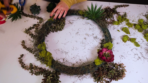 Woman decorates the Floral Craft Ring