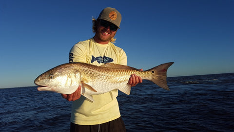 mwc ambassador wolfe with redfish in performance shirt