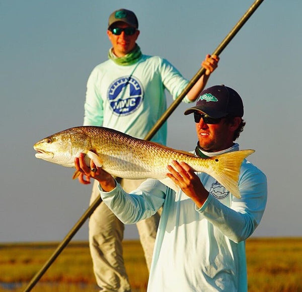 mwc owner logan roberts holding redfish in Louisiana