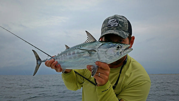 marsh wear ambassador fishing for albacore on the fly wearing MWC hat