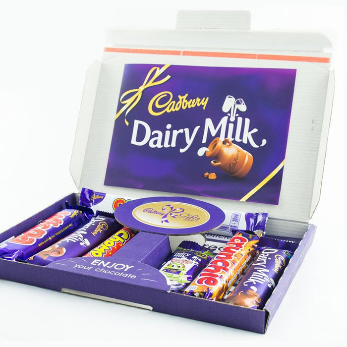 Cadbury selection box postal letter box sized packaging Cadbury postal letterbox sized chocolate packaging deliveries for ecommerce Cadbury selection box letter postal packaging