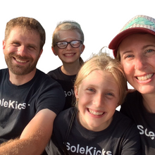Load image into Gallery viewer, The faces behind the Wee-Kicks! Every pair is handcrafted by this loving family who live on the coast of Lake Superior in the North-woods of Wisconsin. They strive to make the world a more kickin' place, one sole at a time.