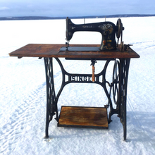 Load image into Gallery viewer, This is the treadle sewing machine that is used to create each pair of Wee-Kicks.  The owner and creator, Zach, enjoys creating shoes and spending time outdoors. When possible he does both at the same time!