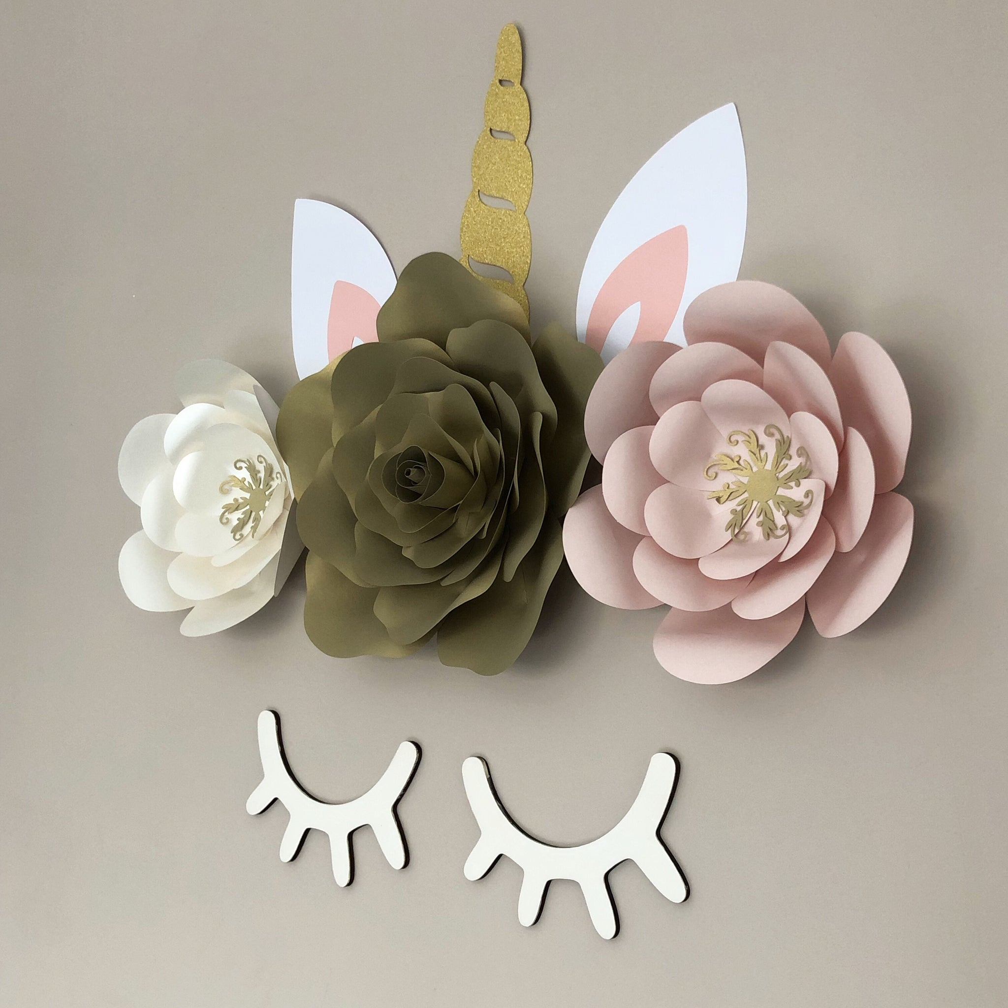 Unicorn paper flower decor with wooden eyelashes and rose middle