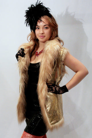 Our model is wearing the High-End Fur Vest in Lion with Gold Snake lining.