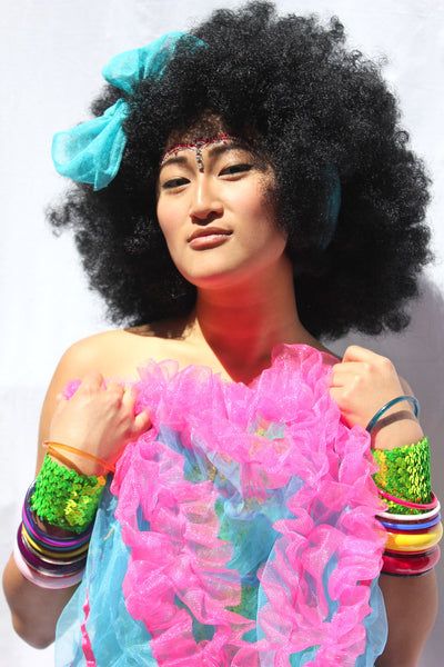 Our model is wearing the Black Afro Wig.