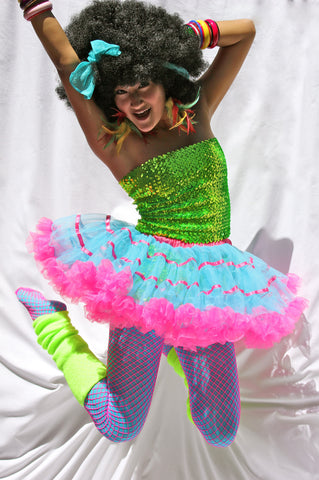 Our model is wearing the Turquoise and Pink Layered Satin Striped Tutu.