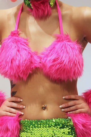 Our model is wearing the fur bikini top in Fuchsia.