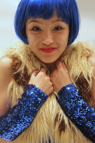 Our model is wearing the medium sequins cuffs in Royal Blue.