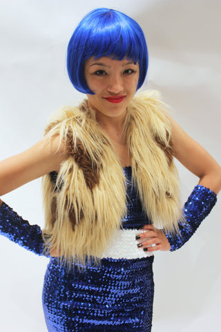 Our model is wearing the High-End Fur Bolero Vest in Camel Long.