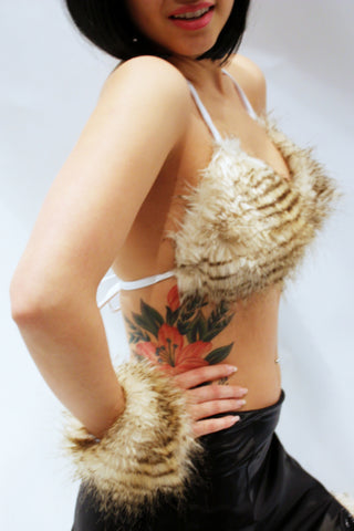 Our model is wearing the high-end fur bikini top in Blonde Raccoon.