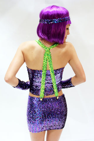 Our model is wearing the sequins suspenders in Neon Green.