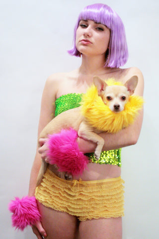 Our models are wearing the fur cuffs in Yellow and Fuchsia.