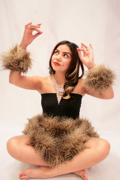 Our model is wearing the High-End Fur Cuffs in Lemur.