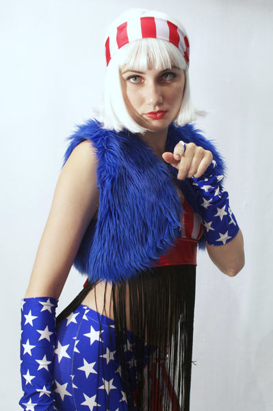 Our model is wearing the Fur Bolero Vest in Royal Blue.